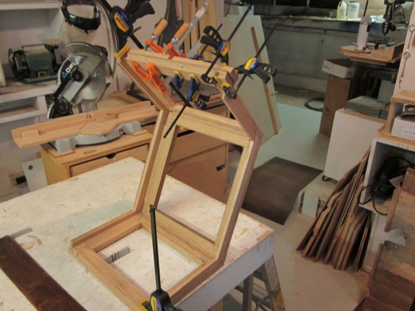 Reliquary, glueing and clamping the veneers onto the substrate