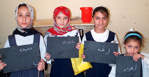 Iraqi schoolgirls with new slates