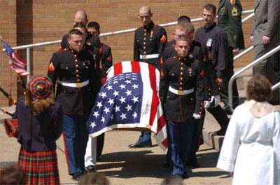 Marines carry the coffin of Lance Cpl. Michael J. Smith Jr