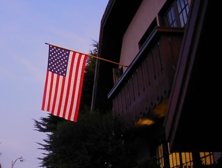Our house with flag at dusk