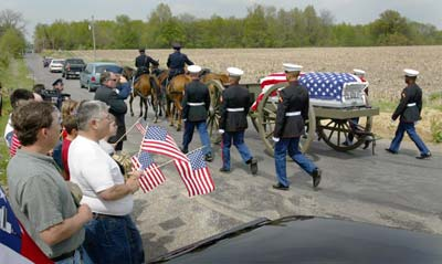 A caisson carries the casket of Cpl. Torrey Stoffel-Gray
