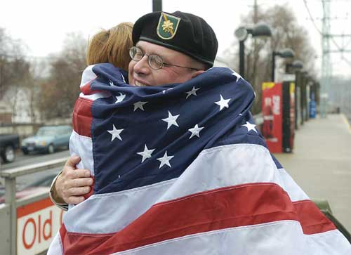 Returning soldier wrapped in flag