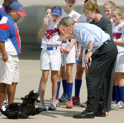 President Bush dropping his dog