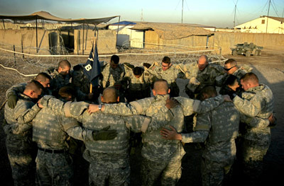 American troops praying before a patrol in Iraq, 2005