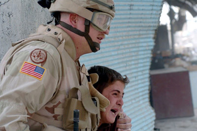 American comforts iraqi boy at suicide bombing