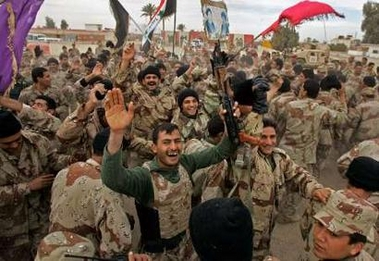 Iraqi soldiers celebrate vote