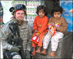 Sgt Richard Wightman III, 80th Division, with children in Taji, Iraq