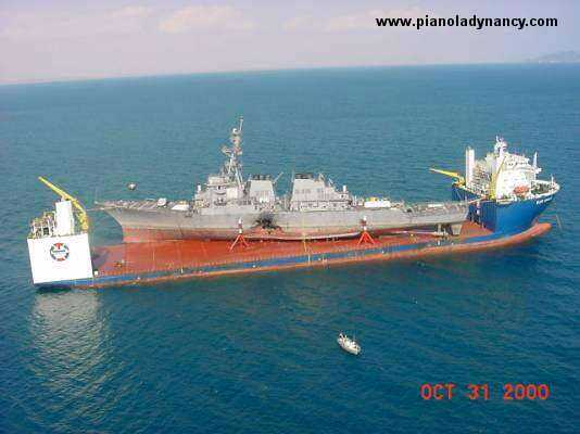 USS Cole on recovery ship