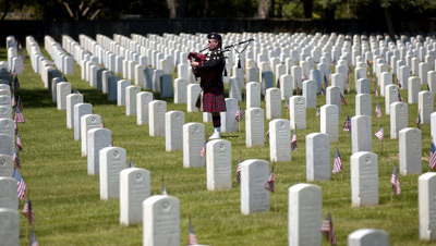 Joe Dodson plays the bagpipe at the Zachary Taylor National Cemetery in Louisville, Ky