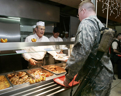 SecDef Donald Rumsfeld serves Christmas Dinner to troops, 12-2004