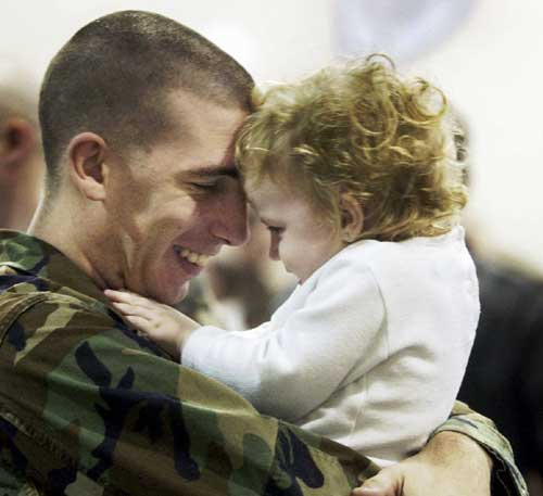 David Castro holds his youngest daughter, Electra, 1, before leaving for Iraq