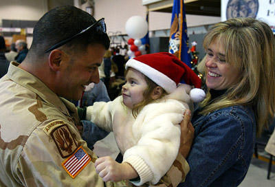 Chief Warrant Officer Mike Marcotte greets his daughter as he returns from Iraq