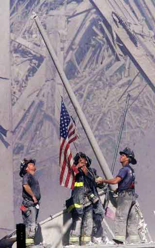 Firefighters raise our flag in WTC ruins