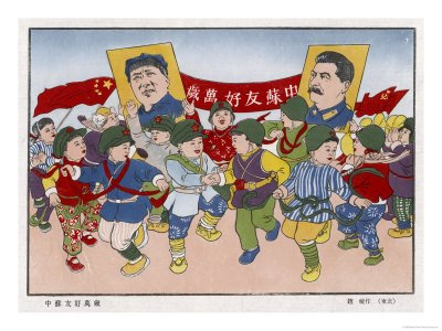 chinese children with portraits of Comrades Mao and Stalin